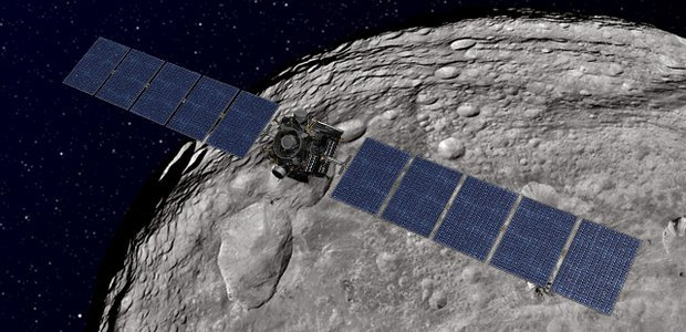 This artist's concept shows NASA's Dawn spacecraft orbiting the giant asteroid Vesta. The depiction of Vesta is based on images obtained by Dawn's framing cameras. Image credit: NASA/JPL-Caltech