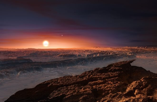 An artist impression of the surface of the candidate planet Proxima b orbiting the red dwarf star Proxima Centauri, the closest star to the Solar System. The double star Alpha Centauri AB also appears in the image. Proxima b is a little more massive than the Earth and orbits in the habitable zone around Proxima Centauri, where the temperature is suitable for liquid water to exist on its surface. (ESO/M. Kornmesser)