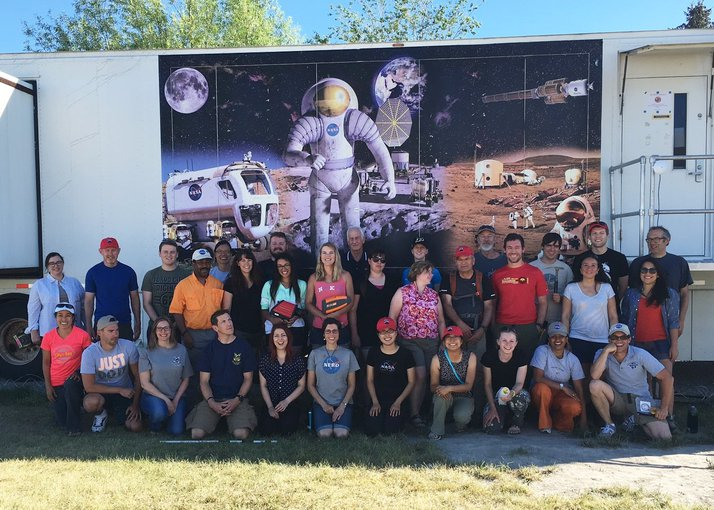 Researchers from NASA Ames' BASALT (Biologic Analog Science Associated with Lava Terrains) project, among which are scientists from the UK Centre for Astrobiology, gather for a photograph during a field trip to Idaho in June 2016.