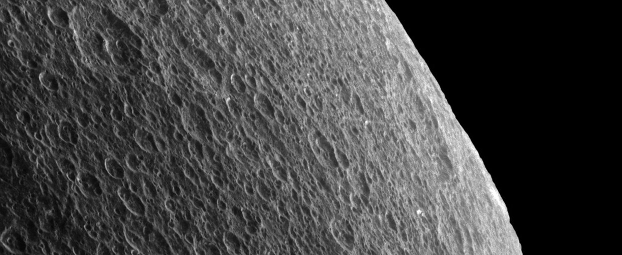 The view was of Saturn's moon Rhea was obtained at a distance of approximately 35,000 miles (56,000 kilometers) from Rhea and at a Sun-Rhea-spacecraft, or phase, angle of 76 degrees. Image scale is 1,100 feet (330 meters) per pixel. Credit: NASA/JPL-Calte