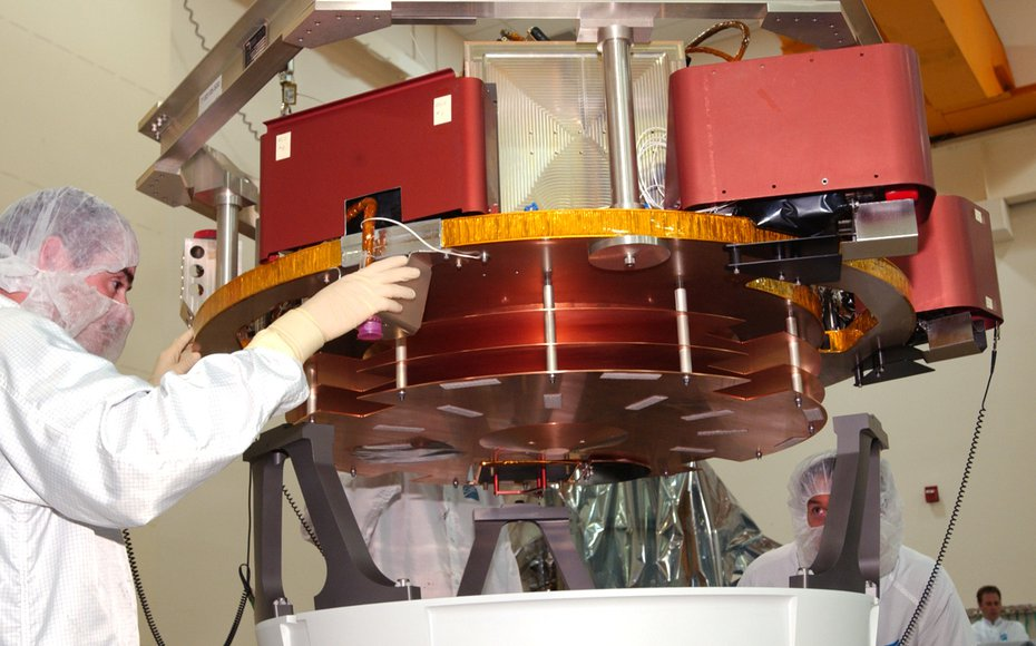 The Impactor Spacecraft being mated with the mounting ring (white ring at bottom of picture with 3 titanium bipods). The thin copper sheets are debris shields to minimize the effects of cometary dust particles hitting the spacecraft.
