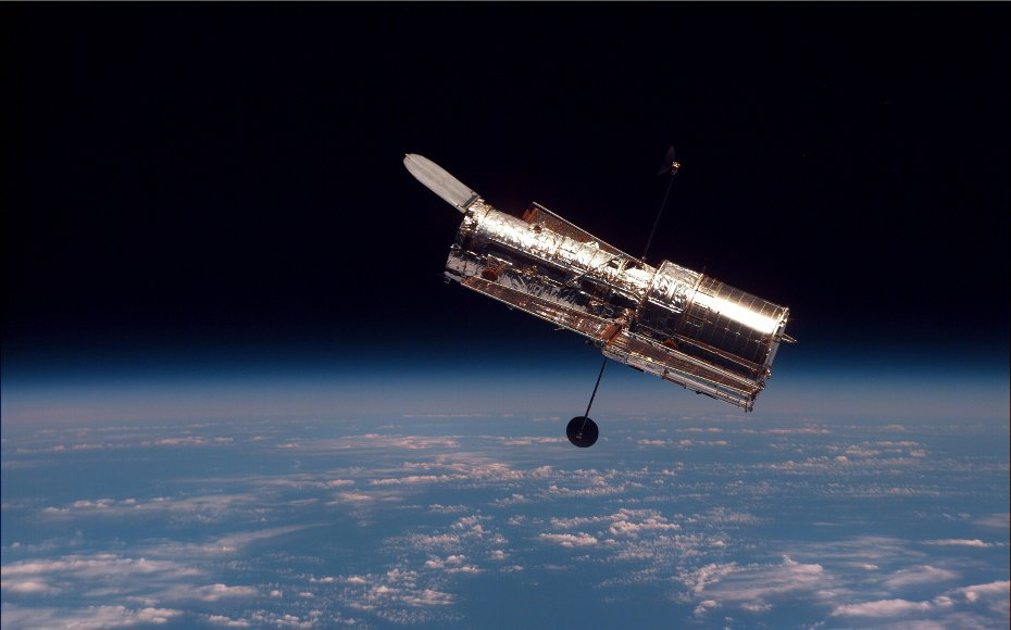 Hubble as seen from Discovery during its second servicing mission.
