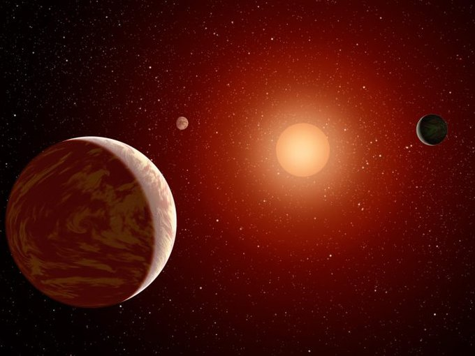Artist rendering of a red dwarf or M star, with three exoplanets orbiting. About 75 percent of all stars in the sky are the cooler, smaller red dwarfs.