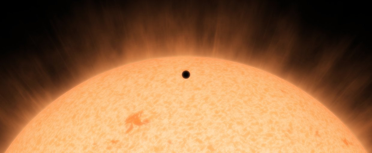 This artist's concept shows the silhouette of a rocky planet, dubbed HD 219134b. At 21 light-years away, the planet is the closest outside of our solar system that can be seen crossing, or transiting, its star.