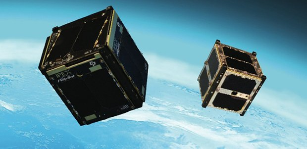 "Artist's concept of the Intelligent Payload Experiment (IPEX) and M-Cubed/COVE-2, two NASA Earth-orbiting cube satellites (""CubeSats"") that were launched as part of the NROL-39 GEMSat mission from California's Vandenberg Air Force Base on Dec. 5, 2013."