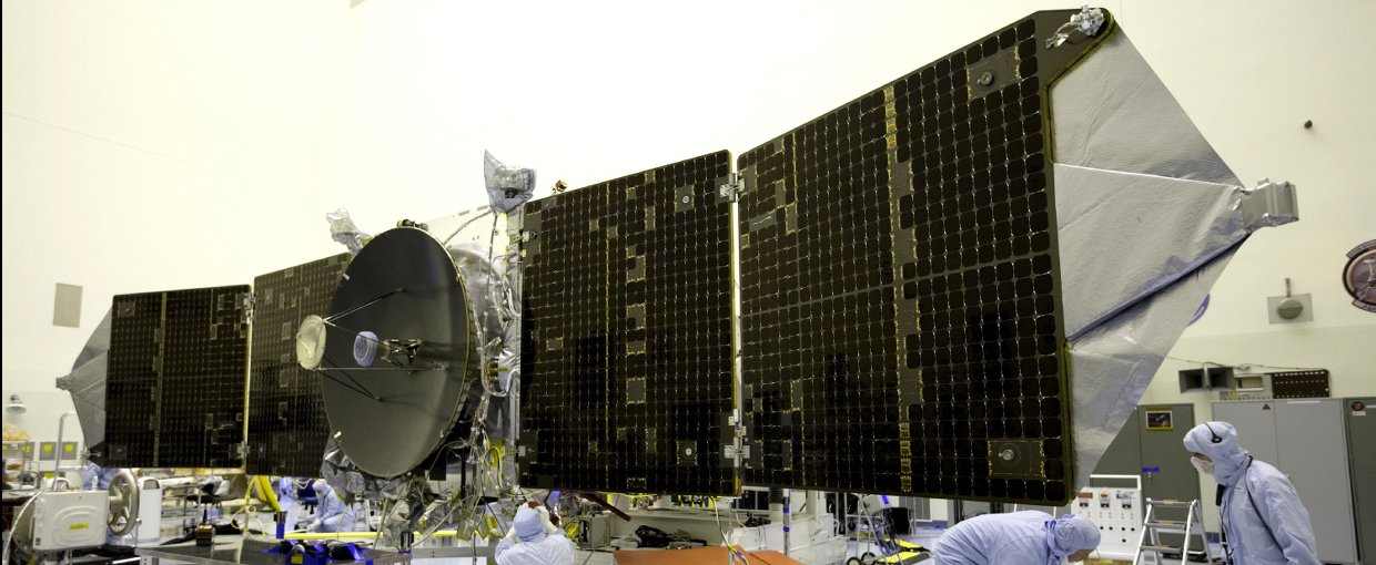 Inside the Payload Hazardous Servicing Facility at NASA's Kennedy Space Center, engineers and technicians test deploy the twin solar arrays on the Mars Atmosphere and Volatile Evolution, or MAVEN, spacecraft.