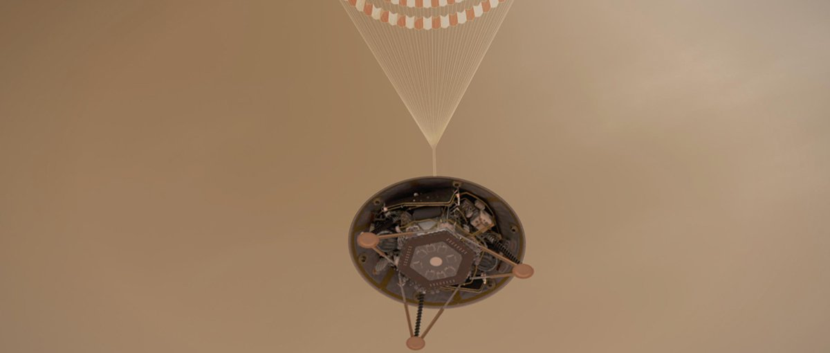 This illustration shows a simulated view of NASA's InSight lander descending on its parachute toward the surface of Mars.