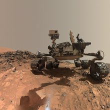 "This low-angle self-portrait of NASA's Curiosity Mars rover shows the vehicle at the site from which it reached down to drill into a rock target called ""Buckskin."" The MAHLI camera on Curiosity's robotic arm took multiple images on Aug. 5, 2015."