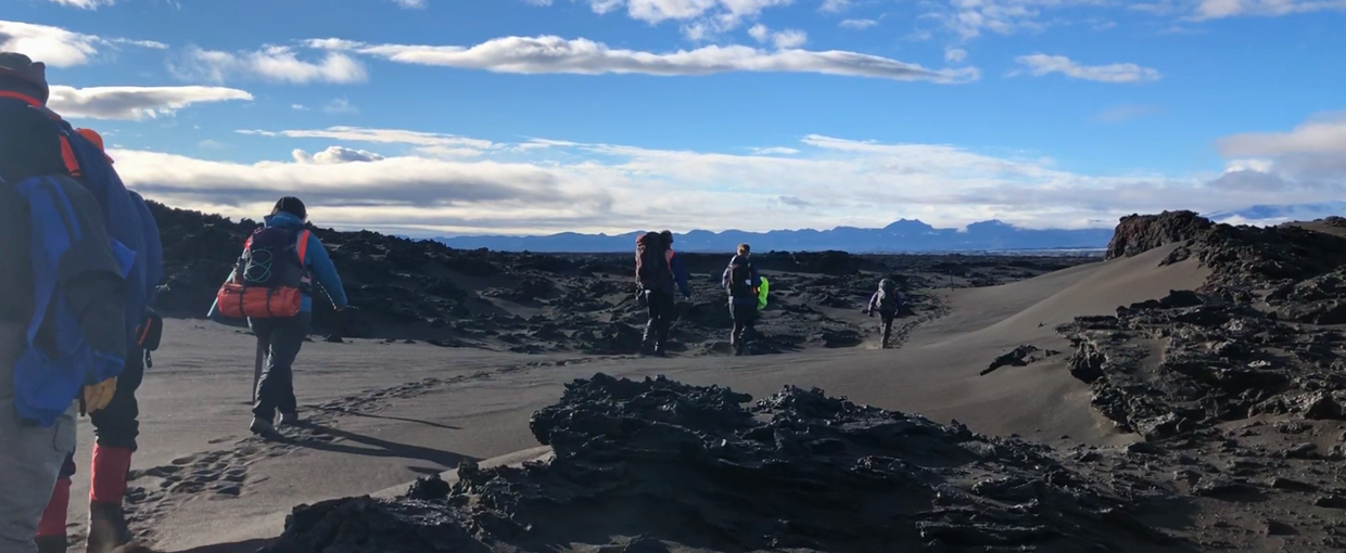 Team FELDSPAR hiking through the lava field of Holuhraun to the main cinder cone. Image by Mike Toillion.