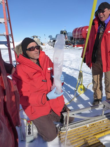 John Priscu (left) and WISSARD Chief Scientist Ross Powell with an ice core extracted from a borehole into Lake Whillans.