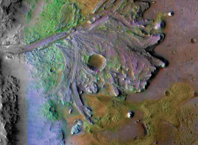 Jezero Crater contains the fossil remains of a river delta and is where the Mars 2020 rover will land.  The image, taken by NASA's Mars Reconnaissance Orbiter (MRO),  uses non-Martian colors to highlight specific features and mineral deposits.