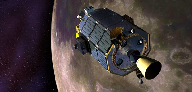 An artist's concept of NASA's Lunar Atmosphere and Dust Environment Explorer (LADEE) spacecraft orbiting the moon and preparing to fire its maneuvering thrusters to maintain a safe orbital altitude. Image credit: NASA Ames / Dana Berry