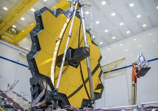 The James Webb Space Telescope is shown with its fully deployed primary mirror at Northrop Grumman's facilities in Redondo Beach, California.