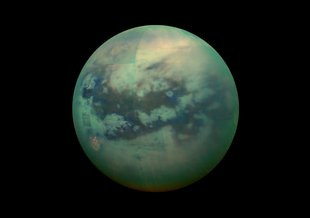 A false-color view of Titan, a moon of Saturn surrounded by a thick orange haze. Titan is believed to contain an ocean with an icy crust on top, which will be simulated in future research.