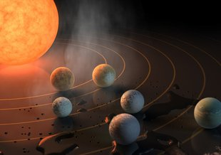 This artist's concept appeared on the Feb. 23, 2017 cover of the journal Nature announcing that the nearby star TRAPPIST-1, an ultra-cool dwarf, has seven Earth-sized planets orbiting it.